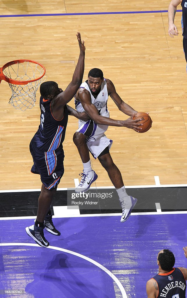 Tyreke Evans #13 of the Sacramento Kings goes up for the shot against DeSagana Diop #2 of the Charlotte Bobcats on March 3, 2013 at Sleep Train Arena in Sacramento, California.
