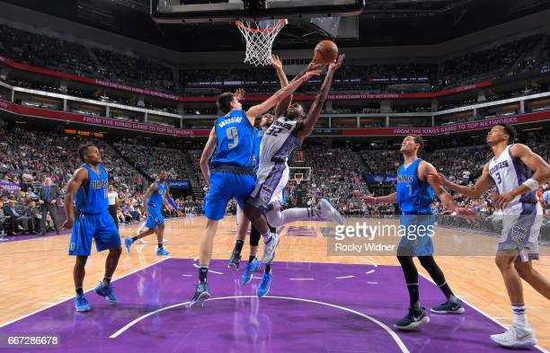 Tyreke Evans of the Sacramento Kings goes up for the shot against Nicolas Brussino of the Dallas Mavericks on April 4 2017 at Golden 1 Center in...