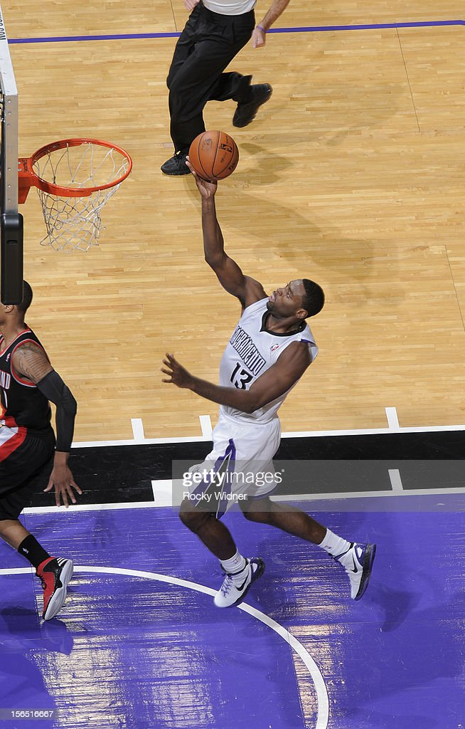 <a gi-track='captionPersonalityLinkClicked' href=/galleries/search?phrase=Tyreke+Evans&family=editorial&specificpeople=4851025 ng-click='$event.stopPropagation()'>Tyreke Evans</a> #13 of the Sacramento Kings lays the ball in against the Portland Trail Blazers on November 13, 2012 at Sleep Train Arena in Sacramento, California.