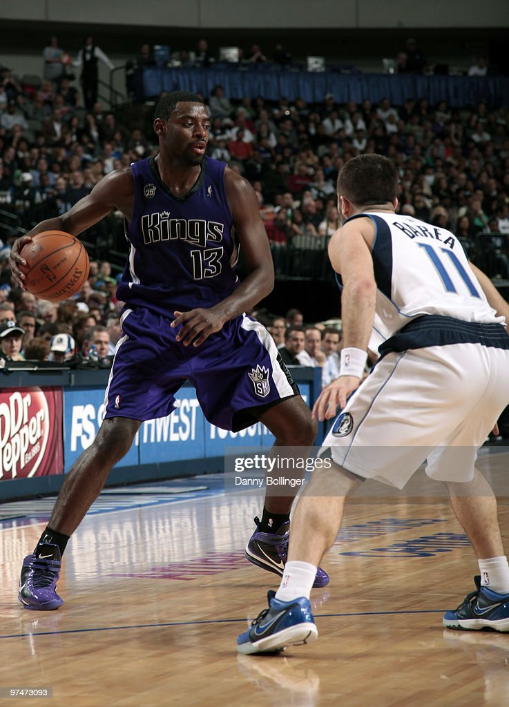 Tyreke Evans #13 of the Sacramento Kings looks to make a move against Jose Juan Barea #11 of the Dallas Mavericks during a game at the American Airlines Center on March 5, 2010 in Dallas, Texas.