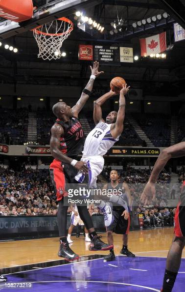Tyreke Evans of the Sacramento Kings puts up a shot against Mickael Pietrus of the Toronto Raptors on December 5 2012 at Sleep Train Arena in...