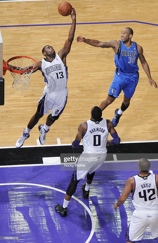 Tyreke Evans #13 of the Sacramento Kings rebounds against Dahntay Jones #30 of the Dallas Mavericks on January 10, 2013 at Sleep Train Arena in Sacramento, California.