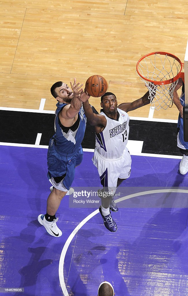 Tyreke Evans #13 of the Sacramento Kings rebounds against Nikola Pekovic #14 of the Minnesota Timberwolves on March 21, 2013 at Sleep Train Arena in Sacramento, California.