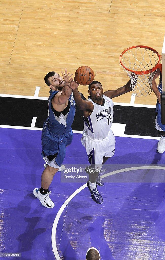 Tyreke Evans #13 of the Sacramento Kings rebounds against Nikola Pekovic #14 of the Minnesota Timberwolves on March 21, 2013 at Sleep Train Arena in Sacramento, California.