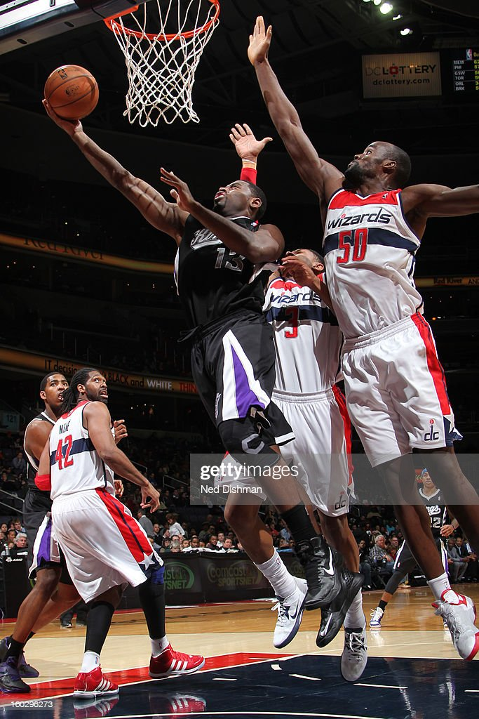 Tyreke Evans #13 of the Sacramento Kings shoots a layup against Bradley Beal #3 and Emeka Okafor #50 of the Washington Wizards during the game at the Verizon Center on January 28, 2013 in Washington, DC.