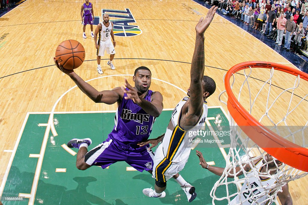 <a gi-track='captionPersonalityLinkClicked' href=/galleries/search?phrase=Tyreke+Evans&family=editorial&specificpeople=4851025 ng-click='$event.stopPropagation()'>Tyreke Evans</a> #13 of the Sacramento Kings shoots a layup against <a gi-track='captionPersonalityLinkClicked' href=/galleries/search?phrase=Marvin+Williams&family=editorial&specificpeople=206784 ng-click='$event.stopPropagation()'>Marvin Williams</a> #2 of the Utah Jazz at Energy Solutions Arena on November 23, 2012 in Salt Lake City, Utah.