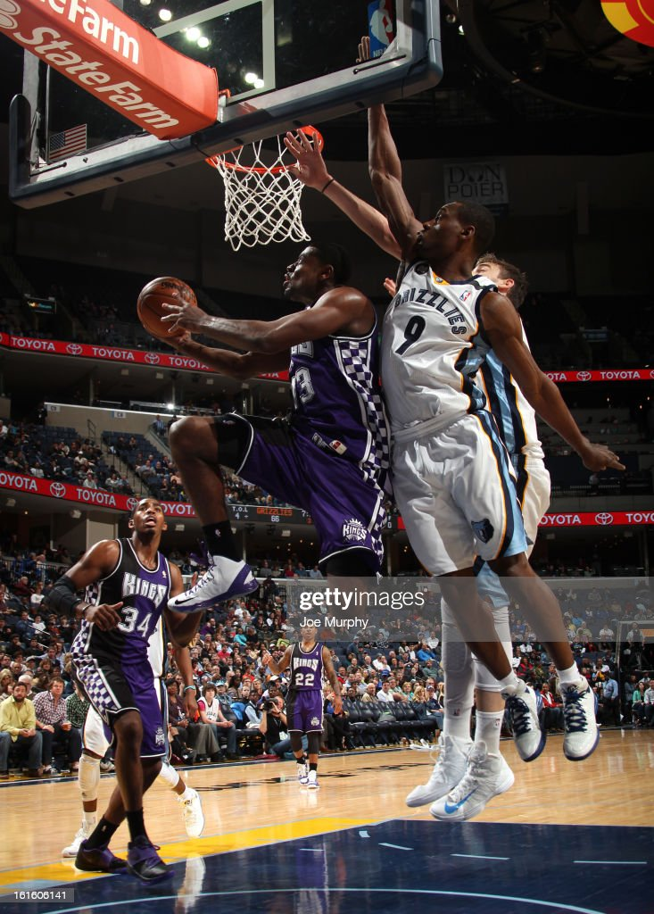 Tyreke Evans #13 of the Sacramento Kings shoots a reverse layup against Tony Allen #9 of the Memphis Grizzlies on February 12, 2013 at FedExForum in Memphis, Tennessee.