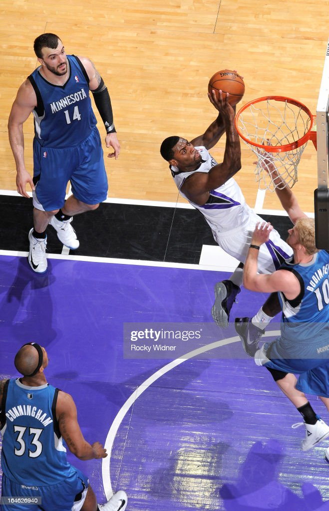 Tyreke Evans #13 of the Sacramento Kings shoots against Chase Budinger #10 of the Minnesota Timberwolves on March 21, 2013 at Sleep Train Arena in Sacramento, California.
