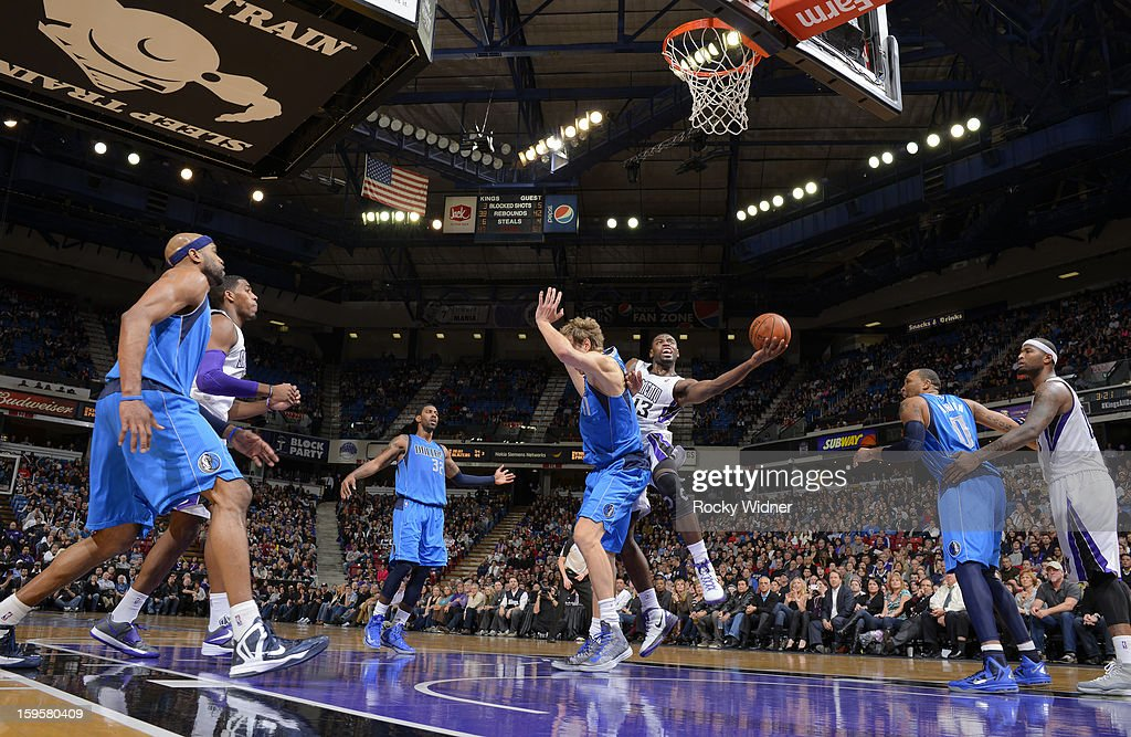 <a gi-track='captionPersonalityLinkClicked' href=/galleries/search?phrase=Tyreke+Evans&family=editorial&specificpeople=4851025 ng-click='$event.stopPropagation()'>Tyreke Evans</a> #13 of the Sacramento Kings shoots against <a gi-track='captionPersonalityLinkClicked' href=/galleries/search?phrase=Dirk+Nowitzki&family=editorial&specificpeople=201490 ng-click='$event.stopPropagation()'>Dirk Nowitzki</a> #41 of the Dallas Mavericks on January 10, 2013 at Sleep Train Arena in Sacramento, California.