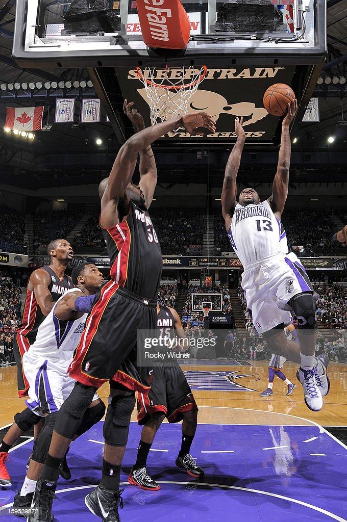 Tyreke Evans #13 of the Sacramento Kings shoots against Joel Anthony #50 of the Miami Heat on January 12, 2013 at Sleep Train Arena in Sacramento, California.