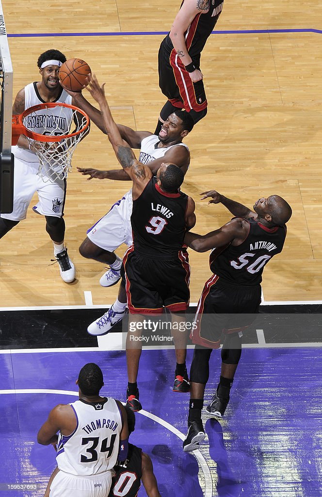 Tyreke Evans #13 of the Sacramento Kings shoots against Rashard Lewis #9 and Joel Anthony #50 of the Miami Heat on January 12, 2013 at Sleep Train Arena in Sacramento, California.