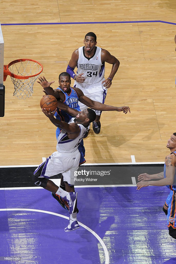 <a gi-track='captionPersonalityLinkClicked' href=/galleries/search?phrase=Tyreke+Evans&family=editorial&specificpeople=4851025 ng-click='$event.stopPropagation()'>Tyreke Evans</a> #13 of the Sacramento Kings shoots against <a gi-track='captionPersonalityLinkClicked' href=/galleries/search?phrase=Serge+Ibaka&family=editorial&specificpeople=5133378 ng-click='$event.stopPropagation()'>Serge Ibaka</a> #9 of the Oklahoma City Thunder on January 25, 2013 at Sleep Train Arena in Sacramento, California.