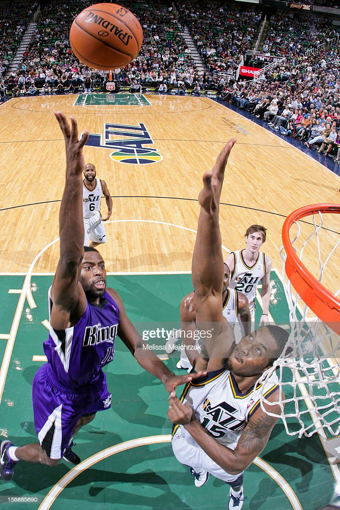<a gi-track='captionPersonalityLinkClicked' href=/galleries/search?phrase=Tyreke+Evans&family=editorial&specificpeople=4851025 ng-click='$event.stopPropagation()'>Tyreke Evans</a> #13 of the Sacramento Kings shoots in the lane against <a gi-track='captionPersonalityLinkClicked' href=/galleries/search?phrase=Derrick+Favors&family=editorial&specificpeople=5792014 ng-click='$event.stopPropagation()'>Derrick Favors</a> #15 of the Utah Jazz at Energy Solutions Arena on November 23, 2012 in Salt Lake City, Utah.