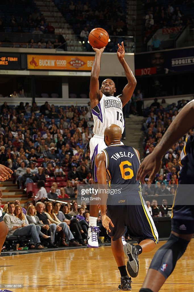 <a gi-track='captionPersonalityLinkClicked' href=/galleries/search?phrase=Tyreke+Evans&family=editorial&specificpeople=4851025 ng-click='$event.stopPropagation()'>Tyreke Evans</a> #13 of the Sacramento Kings shoots the ball against <a gi-track='captionPersonalityLinkClicked' href=/galleries/search?phrase=Jamaal+Tinsley&family=editorial&specificpeople=202203 ng-click='$event.stopPropagation()'>Jamaal Tinsley</a> #6 of the Utah Jazz on November 24, 2012 at Sleep Train Arena in Sacramento, California.