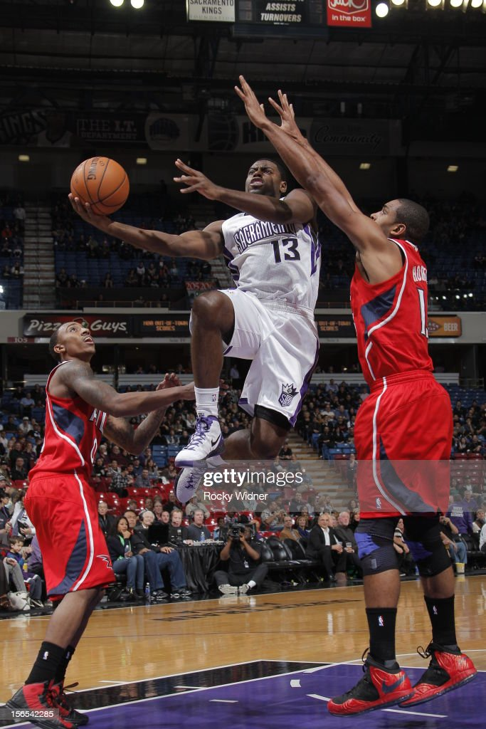 Tyreke Evans #13 of the Sacramento Kings takes the ball to the basket against Al Horford #15 of the Atlanta Hawks on November 16, 2012 at Sleep Train Arena in Sacramento, California.