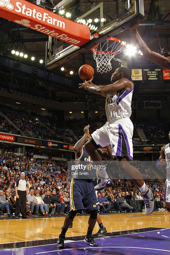 <a gi-track='captionPersonalityLinkClicked' href=/galleries/search?phrase=Tyreke+Evans&family=editorial&specificpeople=4851025 ng-click='$event.stopPropagation()'>Tyreke Evans</a> #13 of the Sacramento Kings takes the ball to the basket against <a gi-track='captionPersonalityLinkClicked' href=/galleries/search?phrase=Marvin+Williams&family=editorial&specificpeople=206784 ng-click='$event.stopPropagation()'>Marvin Williams</a> #2 of the Utah Jazz on November 24, 2012 at Sleep Train Arena in Sacramento, California.
