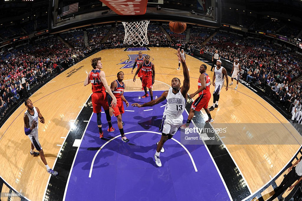 <a gi-track='captionPersonalityLinkClicked' href=/galleries/search?phrase=Tyreke+Evans&family=editorial&specificpeople=4851025 ng-click='$event.stopPropagation()'>Tyreke Evans</a> #13 of the Sacramento Kings takes the ball to the basket against the Washington Wizards on January 16, 2013 at Sleep Train Arena in Sacramento, California.