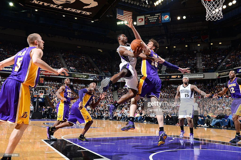 <a gi-track='captionPersonalityLinkClicked' href=/galleries/search?phrase=Tyreke+Evans&family=editorial&specificpeople=4851025 ng-click='$event.stopPropagation()'>Tyreke Evans</a> #13 of the Sacramento Kings takes the ball to the basket against <a gi-track='captionPersonalityLinkClicked' href=/galleries/search?phrase=Pau+Gasol&family=editorial&specificpeople=201587 ng-click='$event.stopPropagation()'>Pau Gasol</a> #16 of the Los Angeles Lakers on March 30, 2013 at Sleep Train Arena in Sacramento, California.
