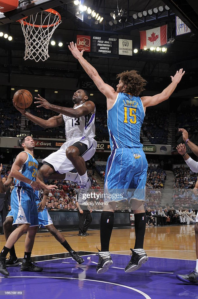 Tyreke Evans #13 of the Sacramento Kings takes the ball to the basket against Robin Lopez #15 of the New Orleans Hornets on April 10, 2013 at Sleep Train Arena in Sacramento, California.