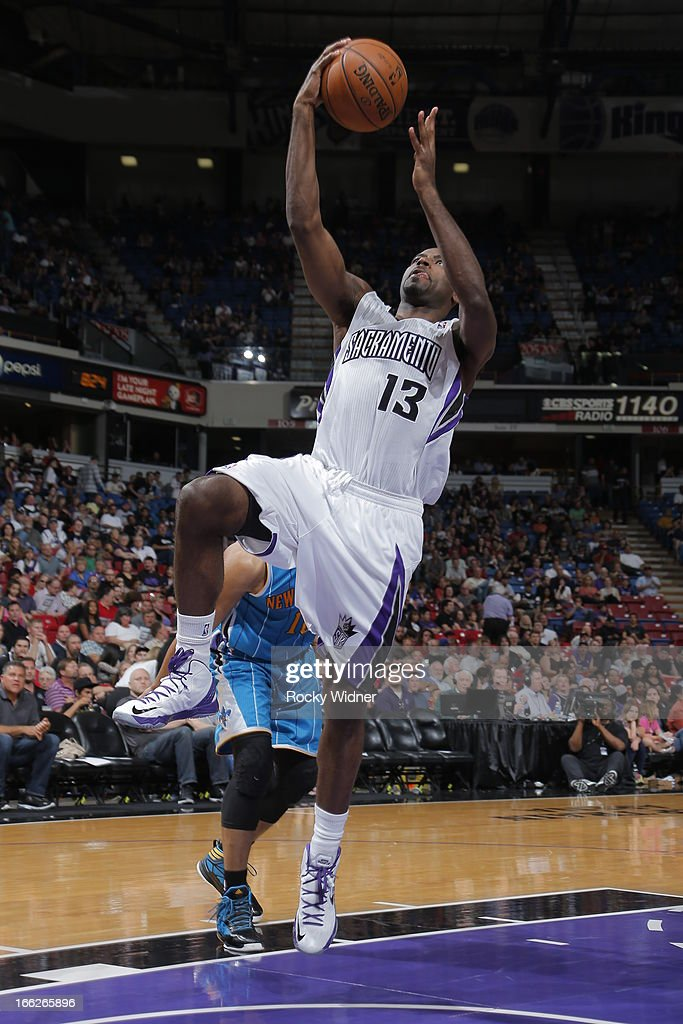 Tyreke Evans #13 of the Sacramento Kings takes the ball to the basket against the New Orleans Hornets on April 10, 2013 at Sleep Train Arena in Sacramento, California.