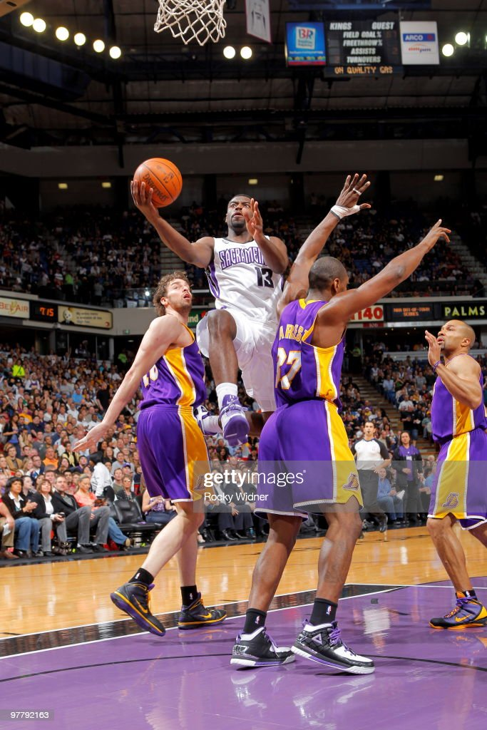 Tyreke Evans #13 of the Sacramento Kings takes the ball to the basket against Ron Artest #37 of the Los Angeles Lakers on March 16, 2010 at ARCO Arena in Sacramento, California.