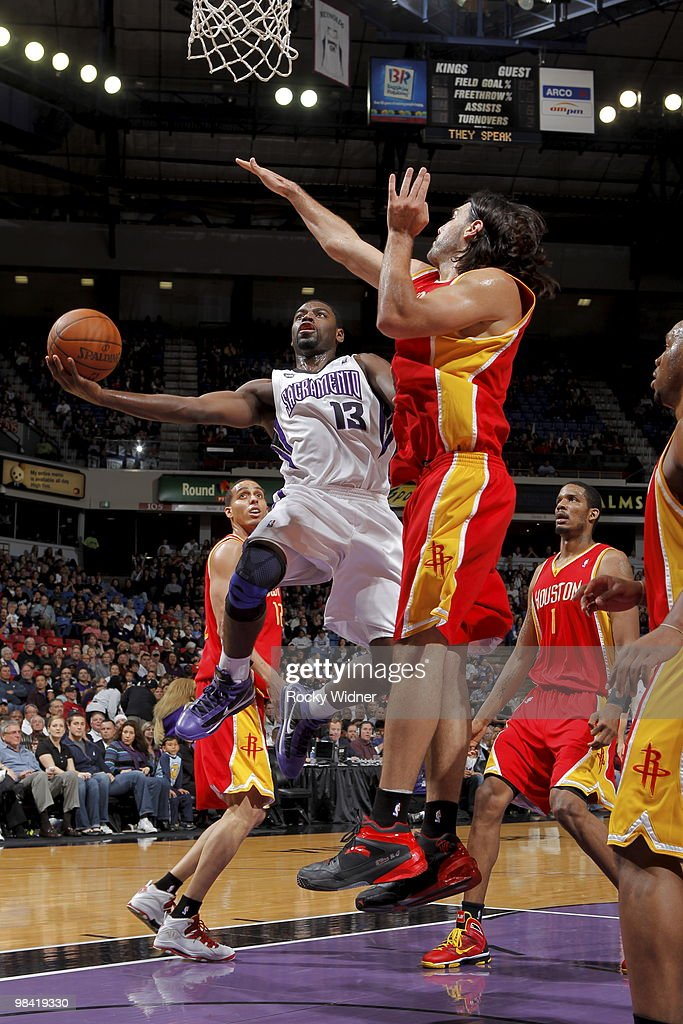 Tyreke Evans #13 of the Sacramento Kings takes the ball to the basket against Luis Scola #4 of the Houston Rockets on April 12, 2010 at ARCO Arena in Sacramento, California.