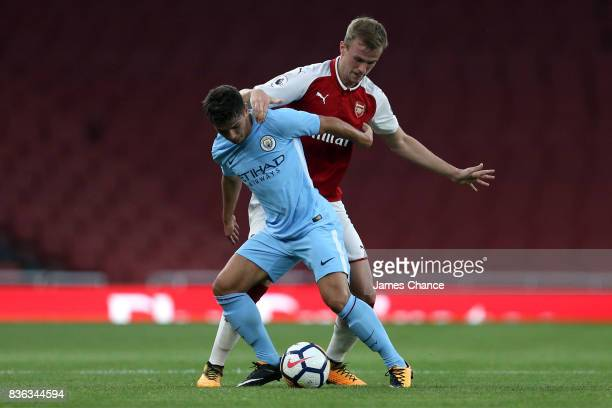 Tyreke Wilson of Manchester City and Rob Holding of Arsenal battle for possesion during the Premier League 2 match between Arsenal v Manchester City...