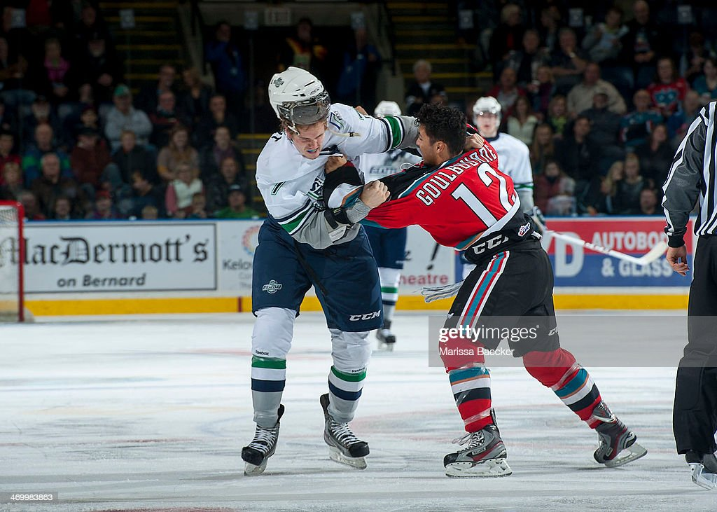Tyrell Goulbourne #12 of the Kelowna Rockets gets in the face of Mitch Elliot #7 of the Seattle Thunderbirds on October 11, 2013 at Prospera Place in Kelowna, British Columbia, Canada