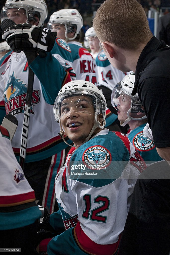 Tyrell Goulbourne #12 of the Kelowna Rockets sits on the bench all smiles after scoring a hat trick against the Prince George Cougars during third period on February 25, 2014 at Prospera Place in Kelowna, British Columbia, Canada.