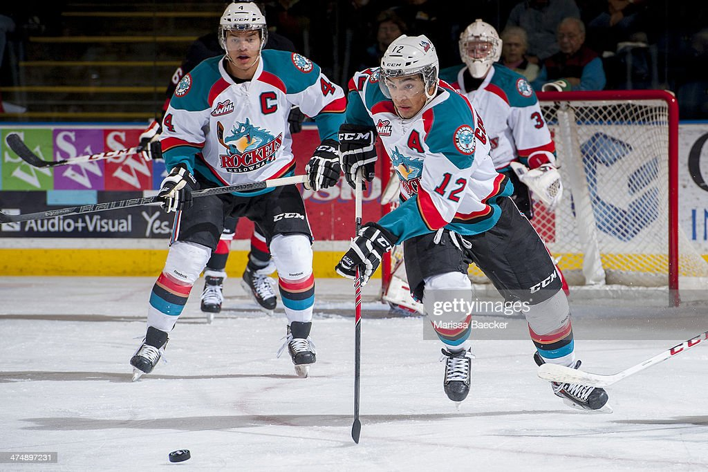 \Tyrell Goulbourne #12 of the Kelowna Rockets skates with the puck against the Prince George Cougars during first period on February 25, 2014 at Prospera Place in Kelowna, British Columbia, Canada.