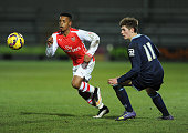 Tyrell Robinson of Arsenal takes on Callum Ainley of Crewe during the match between Arsenal U18 and Crewe Alexandra U18 in the FA Youth Cup 5th Round...