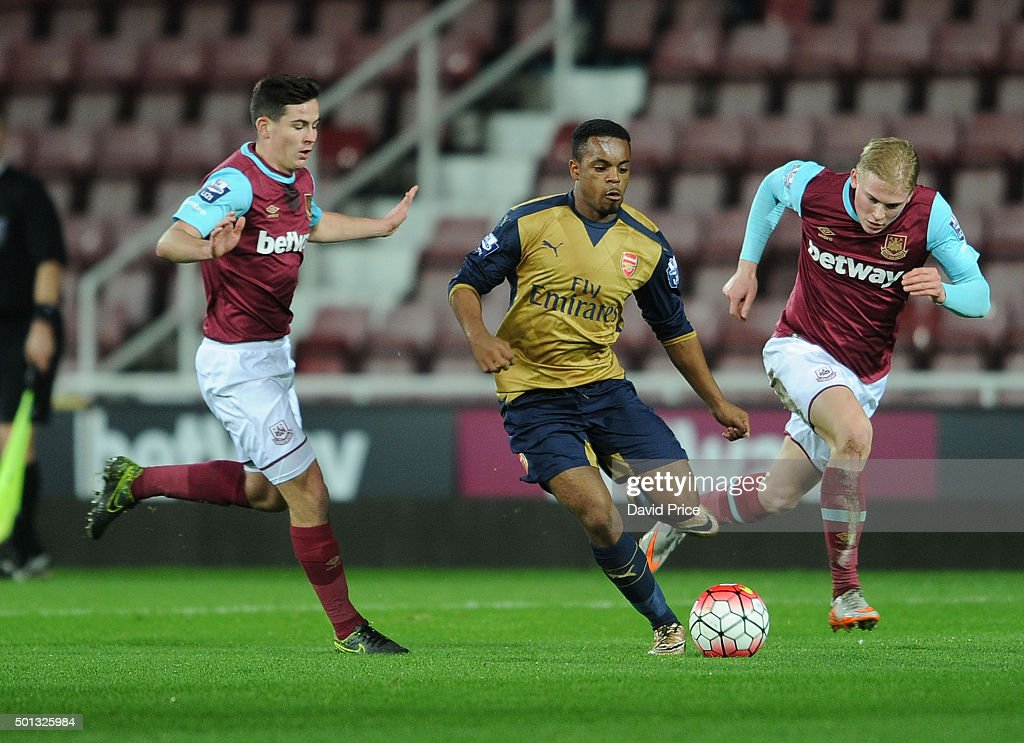 Tyrell Robinson of Arsenal takes on Josh Cullen and Alex Pike of West Ham during match between West Ham United U21 and Arsenal U21 at Boleyn Ground on December 14, 2015 in London, England.