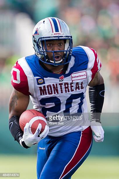 Tyrell Sutton of the Montreal Alouettes runs with the ball in a game between the Montreal Alouettes and Saskatchewan Roughriders in week 8 of the...