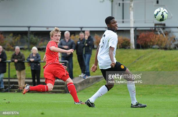 Tyrell Warren of Manchester United looks on as Will Marsh of Liverpool scores during the Barclays Premier League Under 18 fixture between Liverpool...
