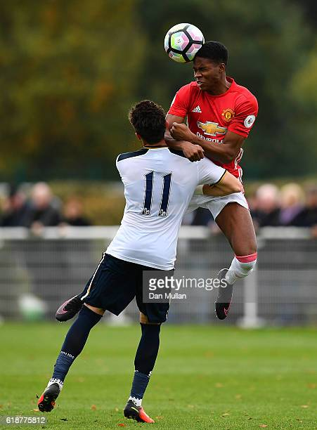 Tyrell Warren of Manchester United rises over Anthony Georgiou of Tottenham Hotspur during the Premier League Two match between Tottenham Hotspur and...