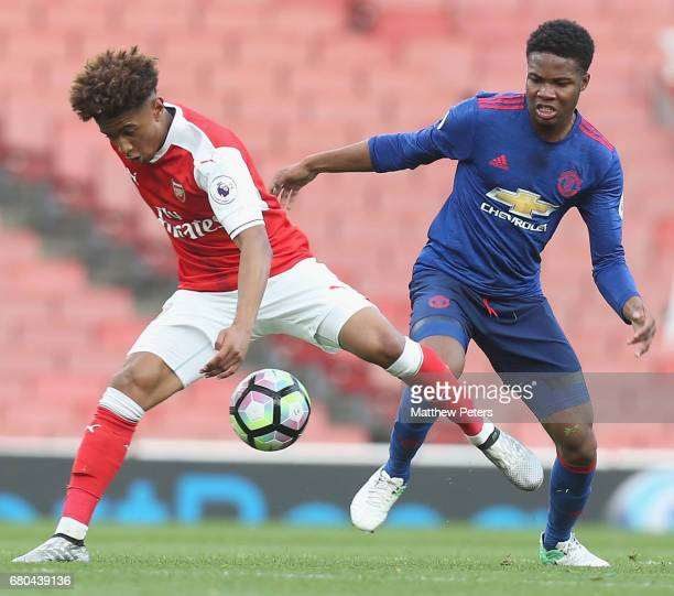 Tyrell Warren of Manchester United U23s in action with Reiss Nelson of Arsenal U23s during the Premier League 2 match between Arsenal U23s and...