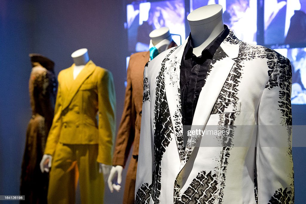 A 'tyre-print' suit, designed by Alexander McQueen and worn by musician and actor David Bowie, is displayed at the 'David Bowie is' exhibition at the Victoria and Albert (V&A) museum in central London on March 20, 2013. Running March 23 to August 11, the exhibition features more than 300 objects that include handwritten lyrics, original costumes, fashion, photography, film, music videos, set designs and Bowie's own instruments. AFP PHOTO/Leon Neal