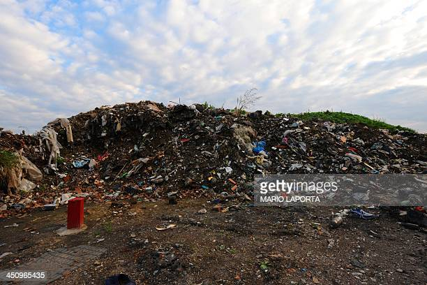 Tyres and burnt toxic waste are left strewn on the sides of an agriculture field near Orta di Atella southern Italy on November 14 2013 Orta di...