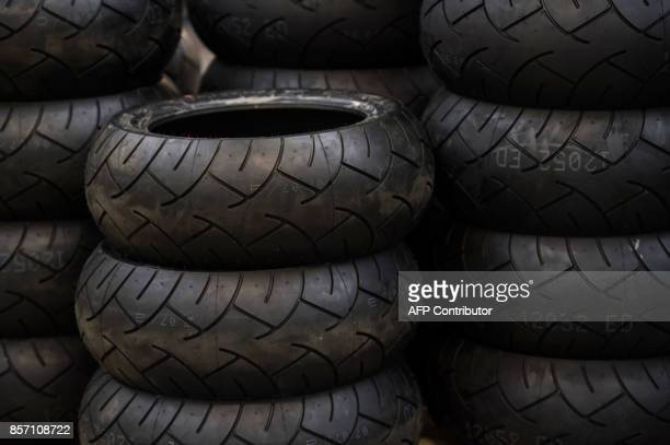 Tyres are piled up adjacent to the assembly line at the Triumph Motorcycles factory in Hinckley central England on October 2 2017 Triumph which was...