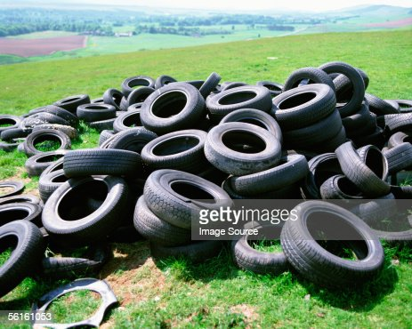 Tyres dumped in countryside : Stock Photo