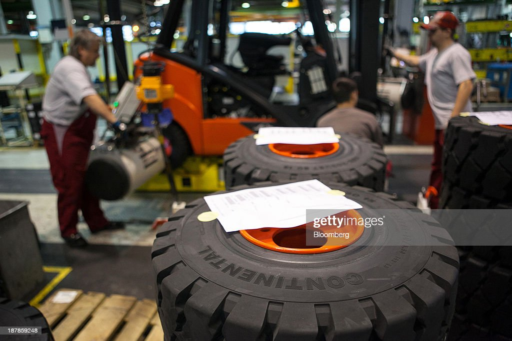 Tyres manufactured by Continental AG sit on the forklift production line at the Linde Material Handling GmbH factory, a unit of Kion Group AG, in Aschaffenburg, Germany, on Tuesday, Nov. 12, 2013. Kion Group AG, the German forklift-maker which listed shares in June, is looking to expand its global sales network via acquisitions to catch up with main competitor Toyota Industries Corp. Photographer: Krisztian Bocsi/Bloomberg via Getty Images