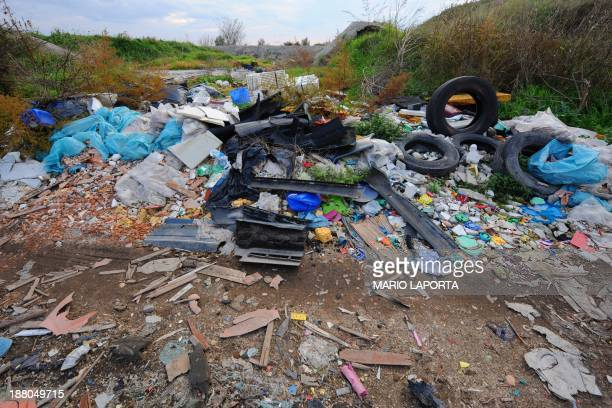 Tyres plastic and toxic waste are left strewn on the sides of an agriculture field near Orta di Atella southern Italy on November 14 2013 Orta di...