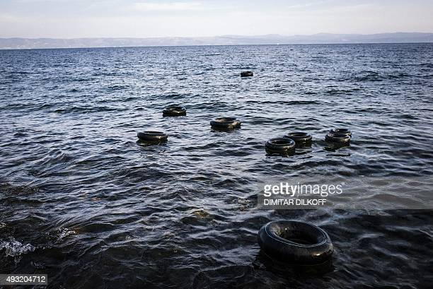 Tyres used for life rings are seen in the Aegean Sea near the Greek island of Lesbos on October 18 2015 The Greek coastguard on October 18 said five...