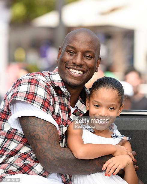 Tyrese Gibson and his daughter Shayla Somer Gibson visit 'Extra' at Universal Studios Hollywood on August 19 2015 in Universal City California
