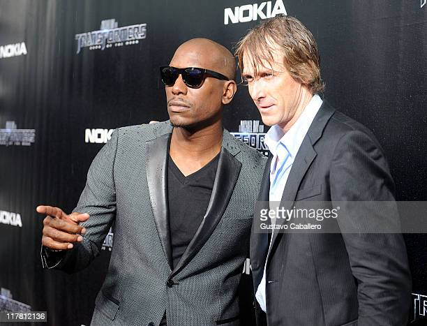 Tyrese Gibson and Michael Bay attends the special red carpet VIP screening of 'Transformers Dark of the Moon' at Regal South Beach on June 30 2011 in...