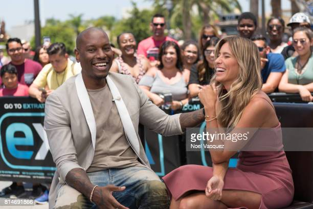 Tyrese Gibson and Renee Bargh visit 'Extra' at Universal Studios Hollywood on July 14 2017 in Universal City California