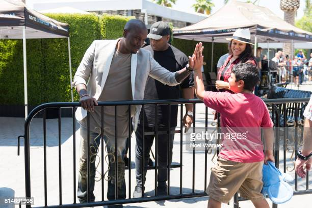 Tyrese Gibson greets a fan at 'Extra' at Universal Studios Hollywood on July 14 2017 in Universal City California
