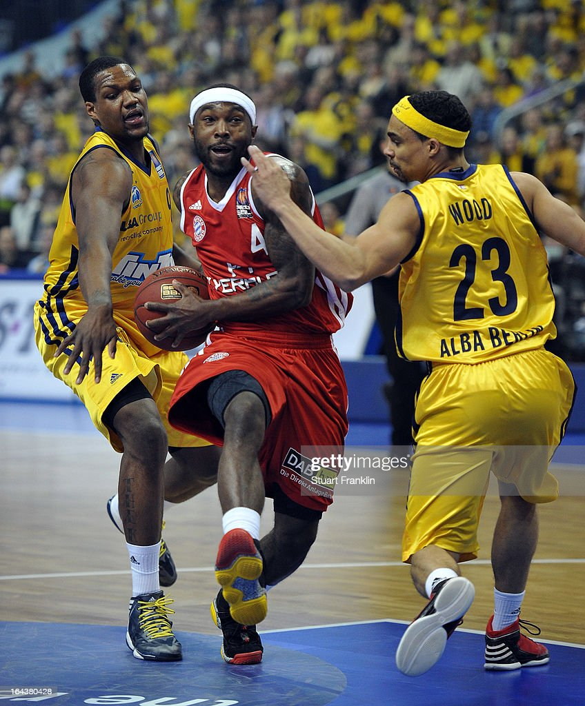 Tyrese Rice of Muenchen is challenged by DaShaun Wood of Berlin during the second semi final match of the Beko Bundesliga Top Four game between ALBA...