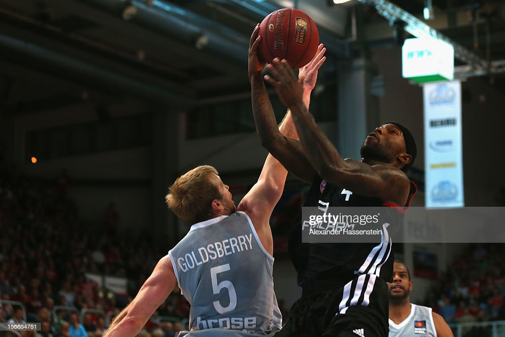 Tyrese Rice (R) of Muenchen shoots against John Goldsberry (L) of Bamberg during the Beko Basketball match between Brose Bamberg and FC Bayern Muenchen at Stechert Arena on November 18, 2012 in Bamberg, Germany.