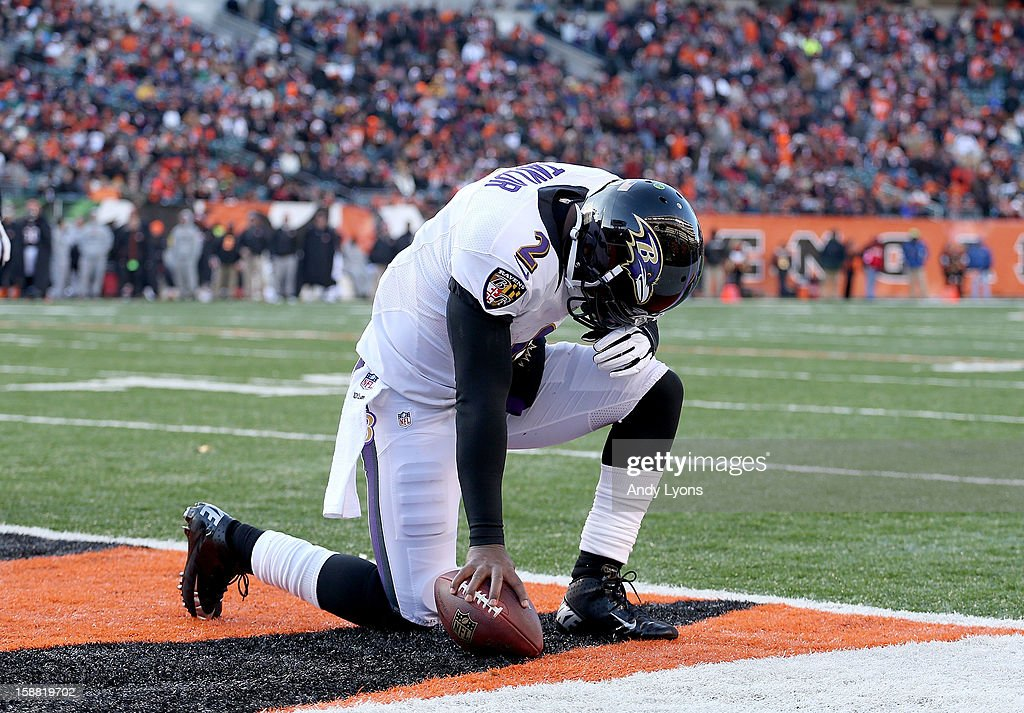 Tyrod Taylor #2 of the Baltimore Ravens celebrates after scoring a touchdown during the NFL game against the Cincinnati Bengals at Paul Brown Stadium on December 30, 2012 in Cincinnati, Ohio.